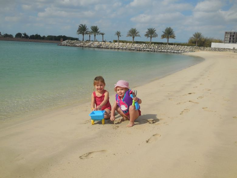 Two CosmopoliClan girls playing on the beach of the Fairmont Bab Al Bahr hotel in Abu Dhabi