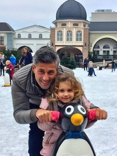 Daddy's little girl ice-skating on the ice)skating rink in Phantasialand, Brühl, assisted by a penguin aid
