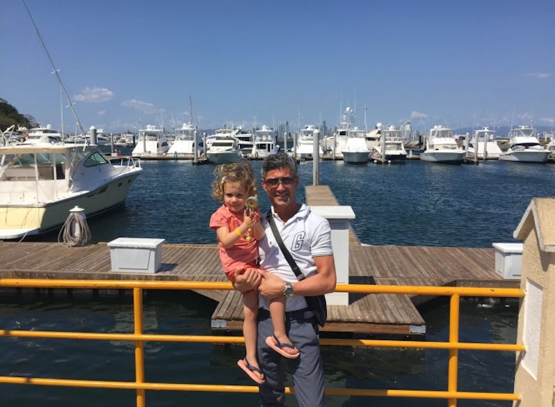 Little girl and her dad posing at the marina at the Amador Causeway during our travel to Panama with kids
