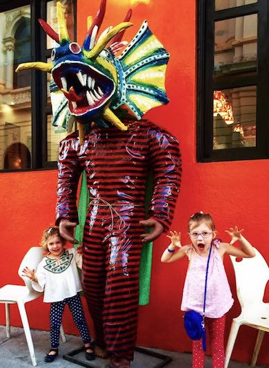During our family trip to colorful Panama, these girls had their picture taken with a diablo sucio statue at the 'Diablicos' restaurant in Casco Viejo