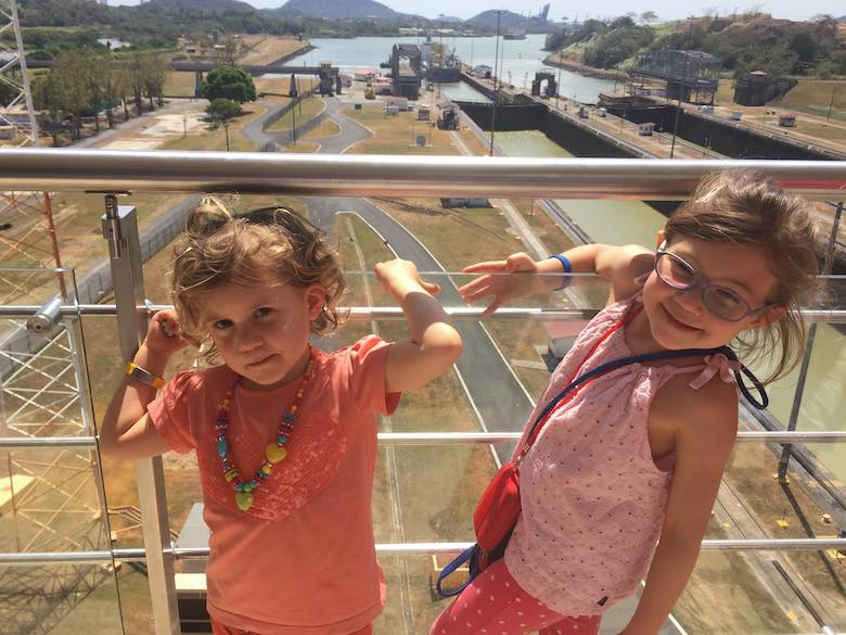 Two little girls posing at the Miraflores docks of the Panama Canal