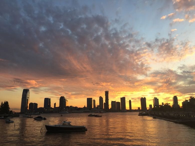 Sunset over the Hudson River and the Jersey City skyline from Pier 25 in TriBeCa during our family adventure in the Big Apple