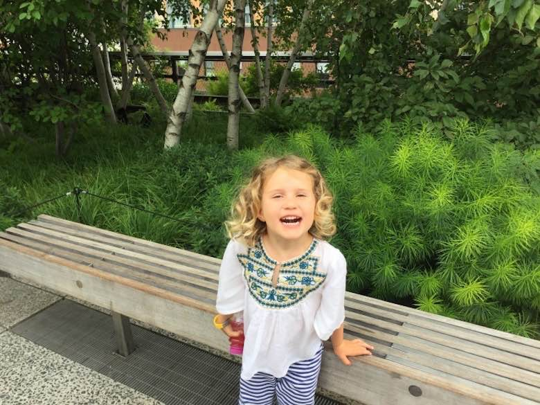 "CosmopoliClan""s little girl laughing out loud on the Highline in NYC"