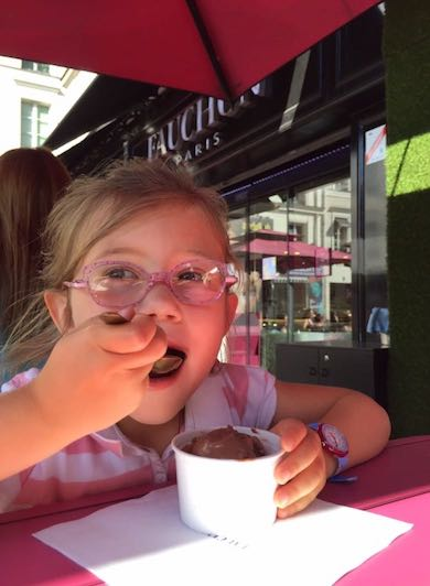 CosmopoliClan's little girl enjoying a chocolate ice cream at Fauchon in Paris