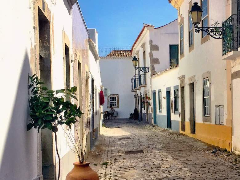 Whitewashed houses and cobblestone streets in the historic center of Faro in authentic Algarve