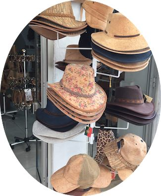 A rack of cork hats in a souvenirshop in Loule in authentic Algarve in Portugal