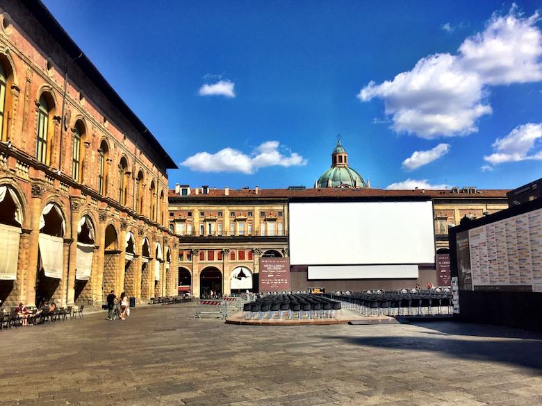 Piazza Maggiore in Bologna, with a large outdoor movie screen for the summer movie season
