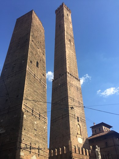 The two towers of Bologna, Garisenda and Asinelli, against a clear blue sky