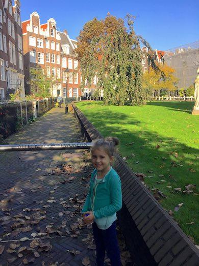 Little girl in the Begijnhof in Amsterdam