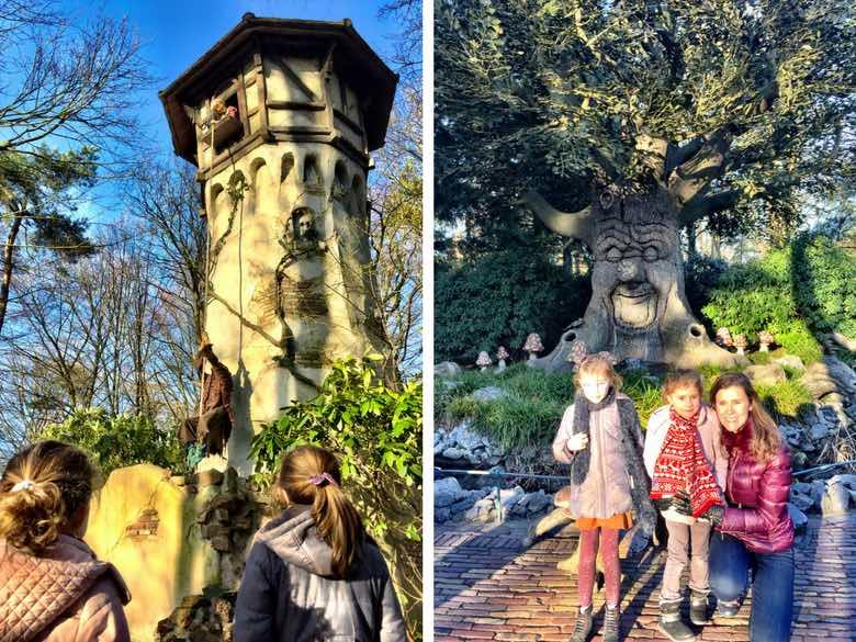 Twee kleine meiden kijken naar Rapunzel en de Sprookjesboom in het Efteling Sprookjesbos