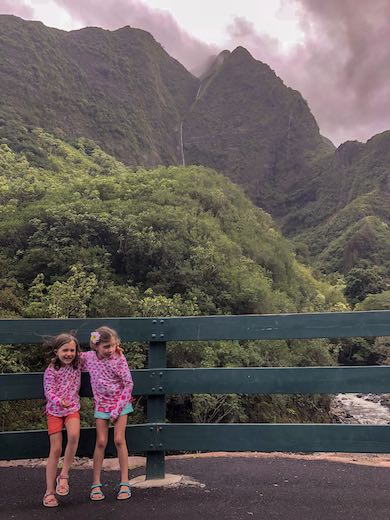 Two little girls having fun at 'Iao Valley in Maui with kids