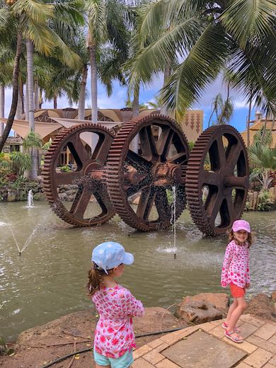 Two little girls exploring Maui Tropical Plantation, family fun in Maui