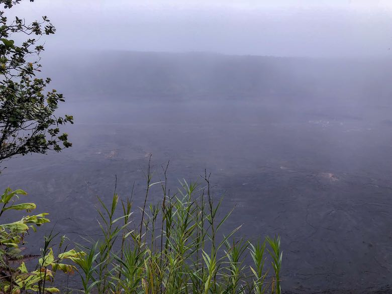 Foggy view from the Kilauea Iki Trail over the crater in Hawaii Volcanoes National Park