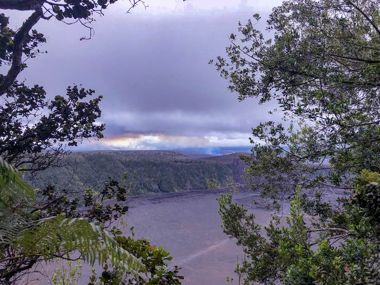 Viewpoint from the rainforest over the crater while hiking the Kilauea Iki Trail in Hawaii Volcanoes National Park