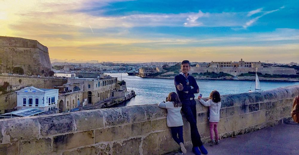 A dad and his two girls overlooking the water-taxi harbour between Valletta and Sliema