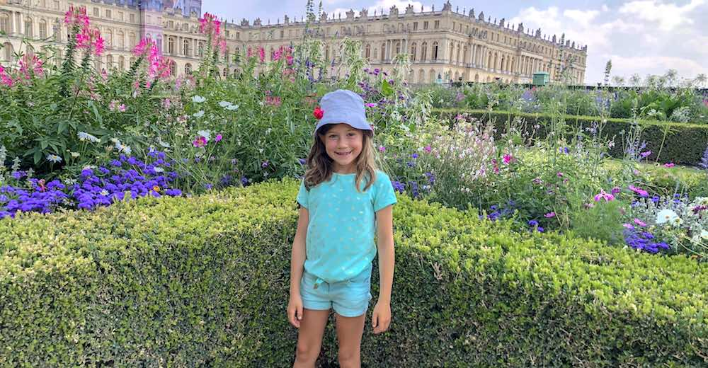 Admiring the Musical Fountains Show during a Paris to Versailles day trip