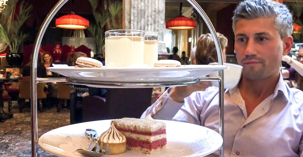 My husband enjoying his high tea at the Hotel des Indes, one of the ultimate things to do in The Hague