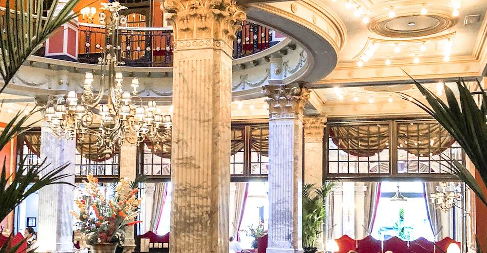 The interior of the bar area at the iconic Hotel des Indes, one of the best places to visit in The Hague