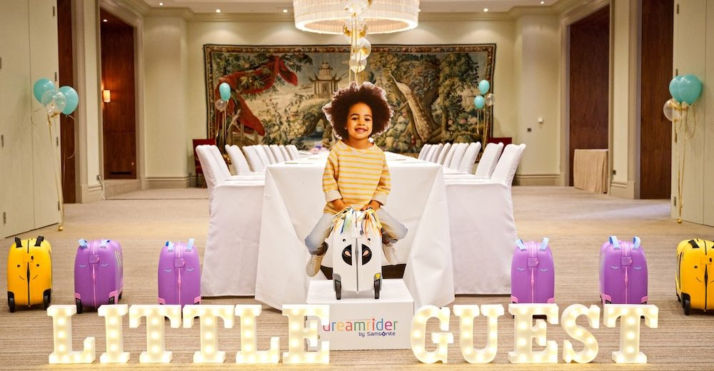 Colorful Samsonite DreamRider suitcases offered by The Little Guest Hotels Collection for every 10th night of booking