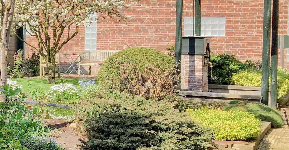 A water pump in the courtyard of the Hofje van Bakenes, the oldest hofje of Haarlem Netherlands