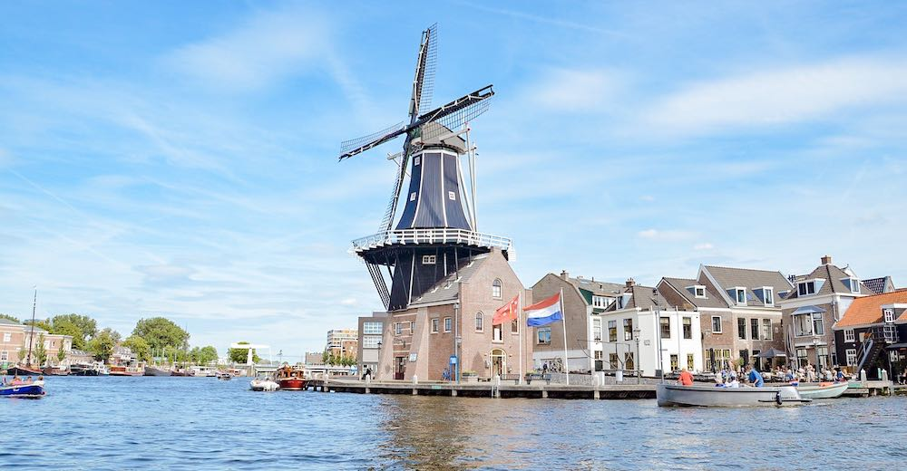 De Adriaan Windmill, one of the city's most famous landmarks along the Spaarne river and one of the best things to do in Haarlem The Netherlands