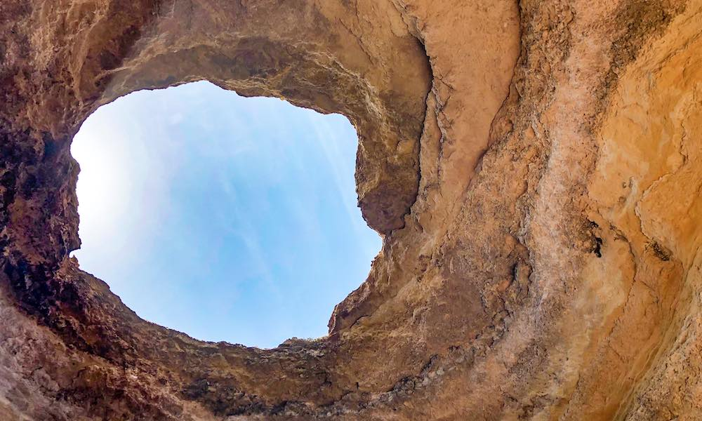 Eye of the Benagil cave in the Algarve Portugal