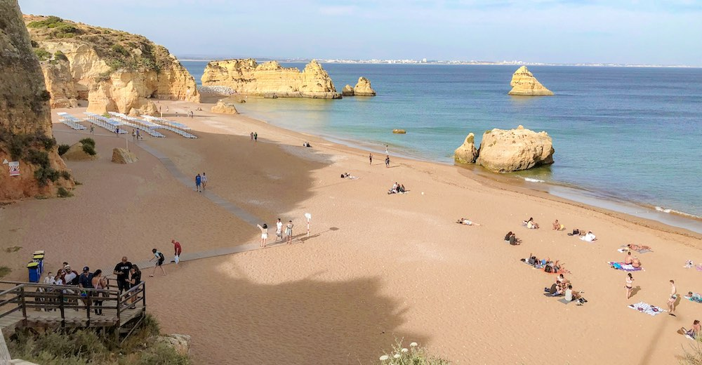 A view over Praia da Dona Ana beach in Portugal from up on the cliff