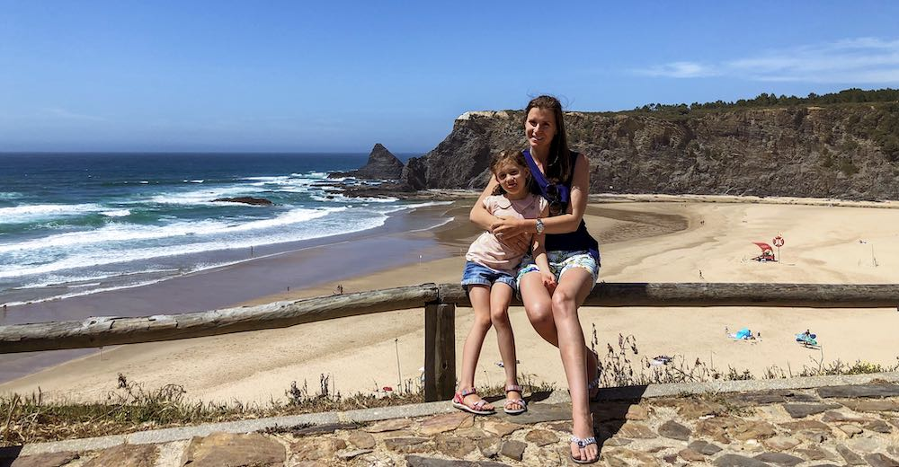 Mother and daughter at Praia de Odeceixe beach along the Portugal coast