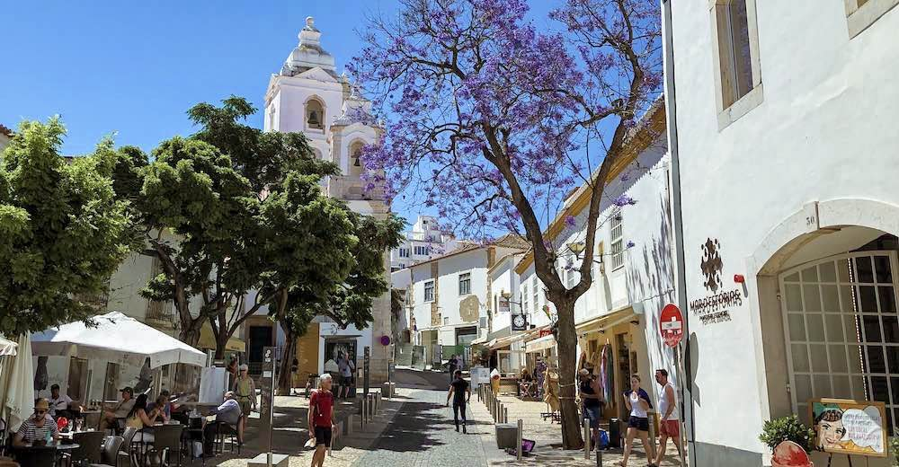 Picturesque street in Lagos old town Portugal, and a view of the Igreja de Santo António (church), a Lagos must-see