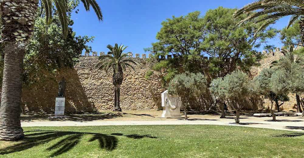 Walls and trees in front of the Castelo de Lagos or Lagos Castle, also known as the Governor's Castle or Castelo dos Governadores in Lagos