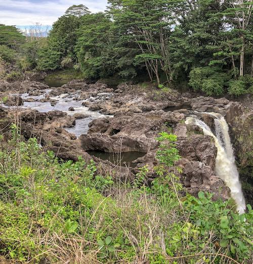 Upstream Wailuku river from Rainbow Falls you'll find Peepee Falls Big Island waterfalls