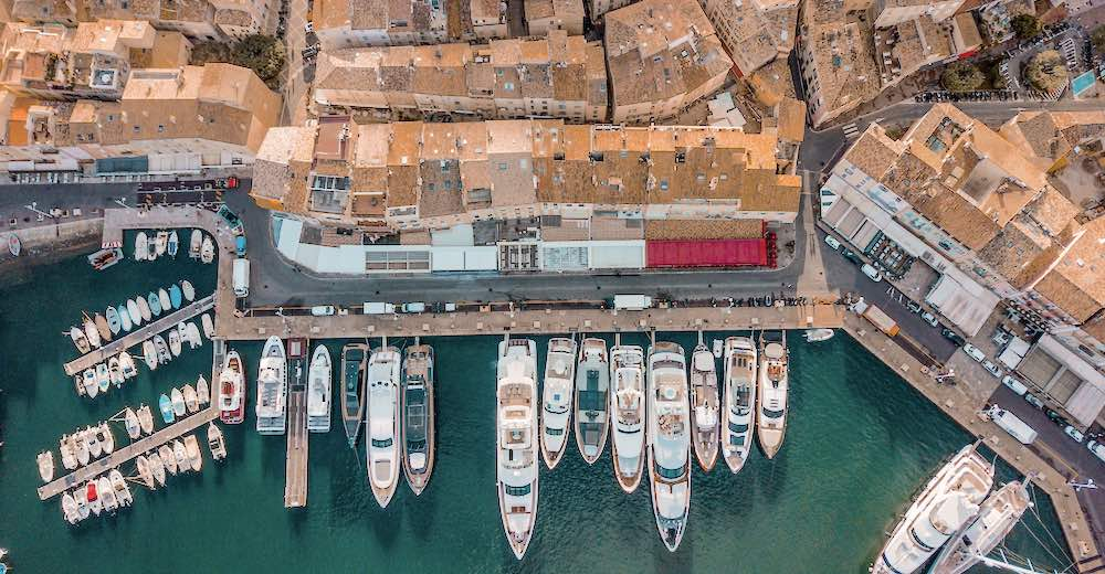 Drone photo of the Port of St Tropez France with yachts moored along the quai