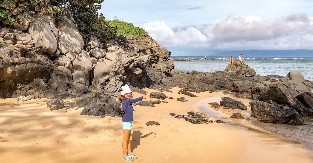 Little girl on Kapalua beach which is one of the best places to stay in Maui Hawaii