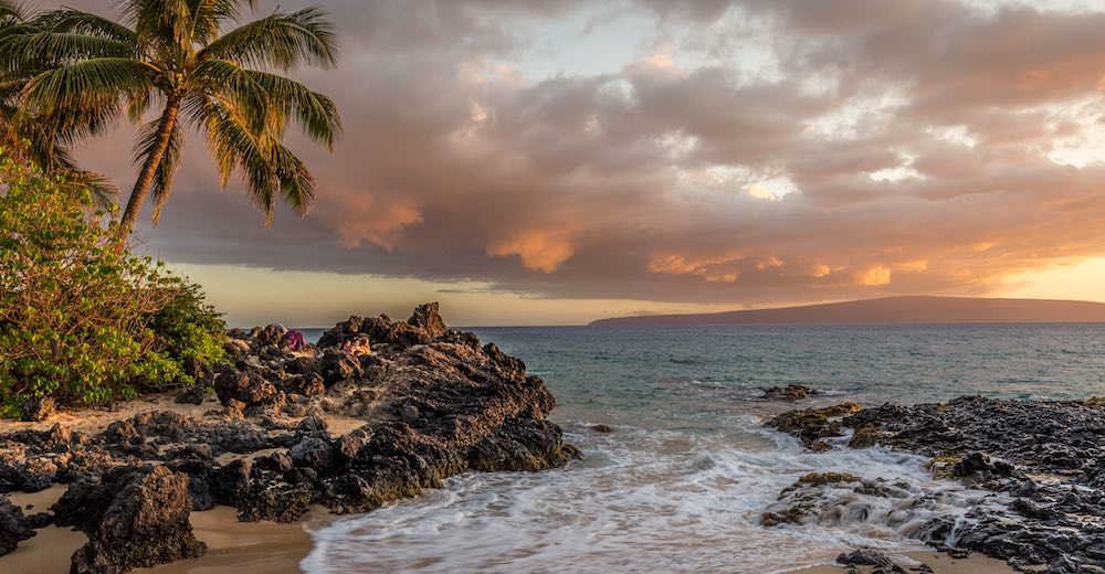 Sunset on the beach in Kihei, which has a very central location, an important consideration when deciding where to stay in Maui Hawaii