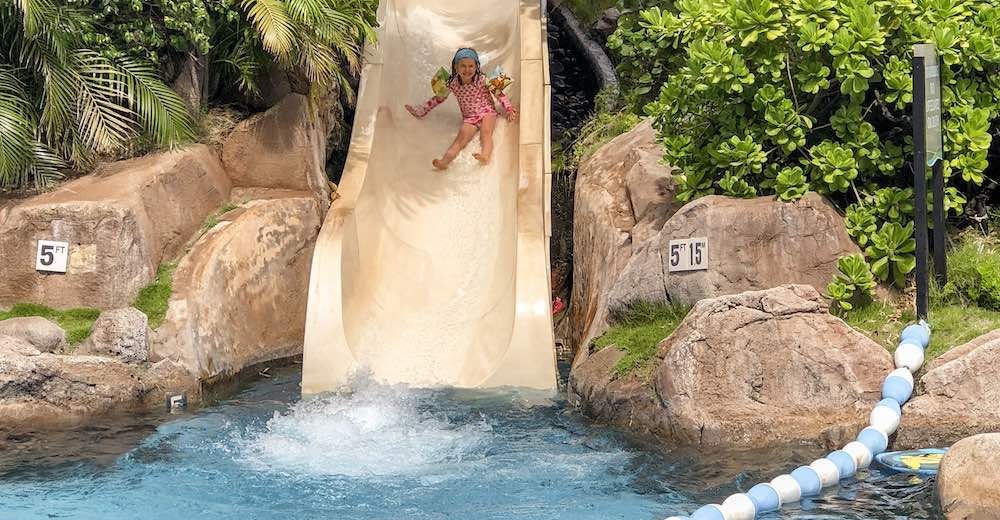 Girl sliding down the pool slide in the Westin Maui Resort and Spa, one of the best Maui hotels