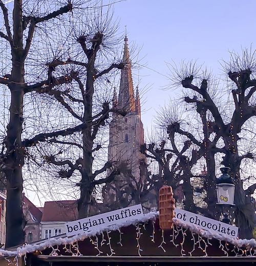 Eat all the waffles you can get from the Bruges Christmas market stalls