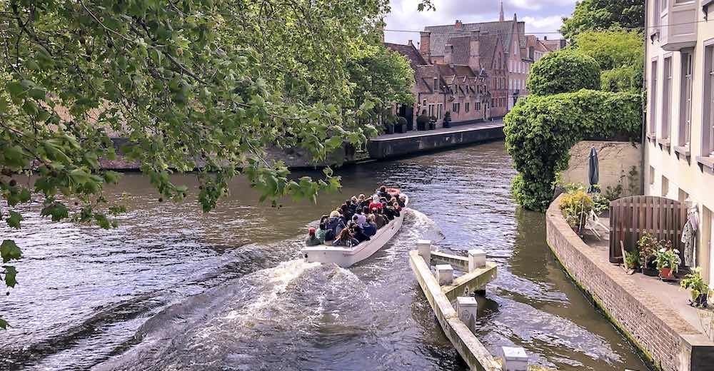 Taking a boat tour to see the best of Brugge during the winter festivities