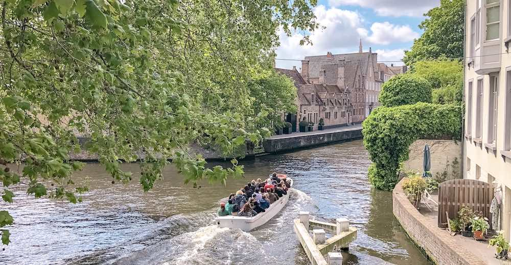 Boat on a canal tour in Bruges, the medieval city in Belgium