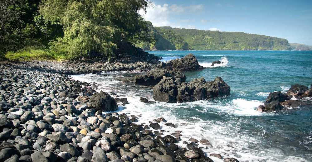 Wild ocean and black lava rock at Keanae, one of the Road to Hana stops