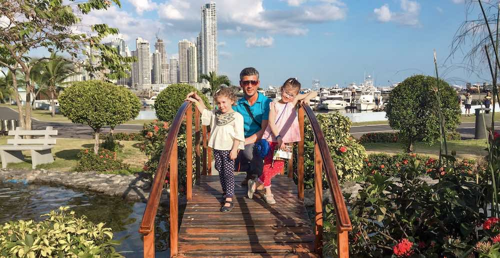 Family posing on a park bridge at the Cinta Costera in Panama City Panama