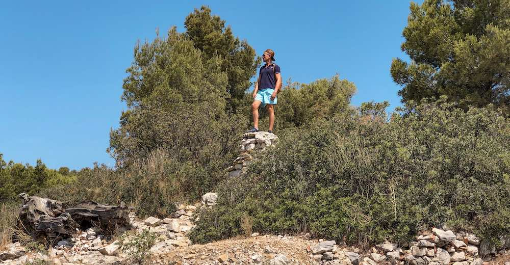 Man standing on a rock in the Calanques National Park in Cassis, Provence