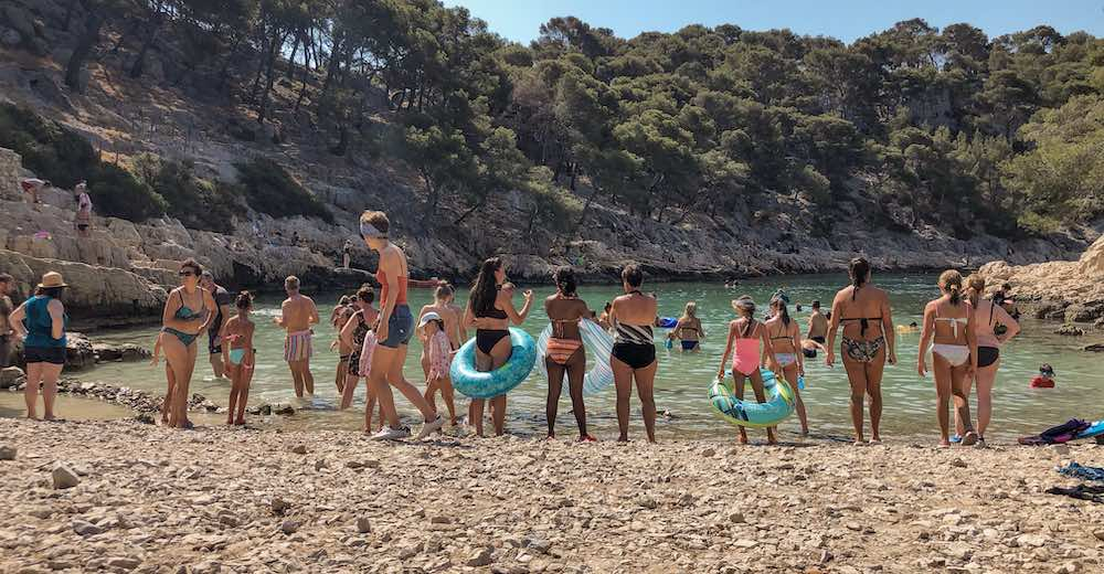 Line of bathers blocking the view of the Calanques near Cassis, Provence