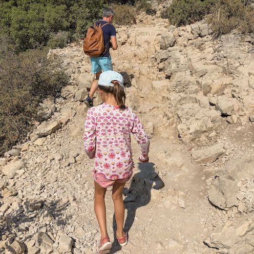 Father and daughter on a rocky hiking trail at the National Park Calanques de Cassis