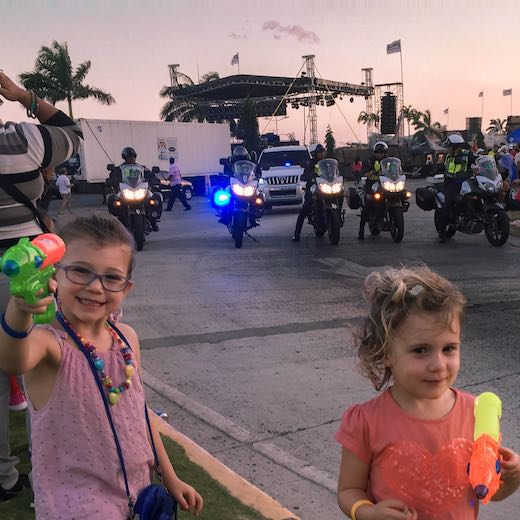 Two little girls holding waterpistols during the Panama City carnaval parade