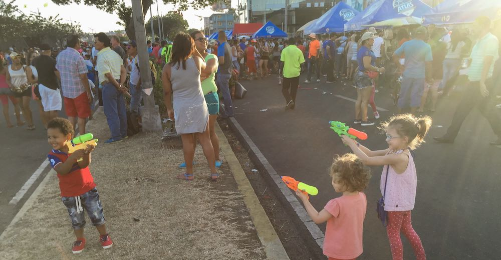 Children playing with water pistols during carnival Panama City