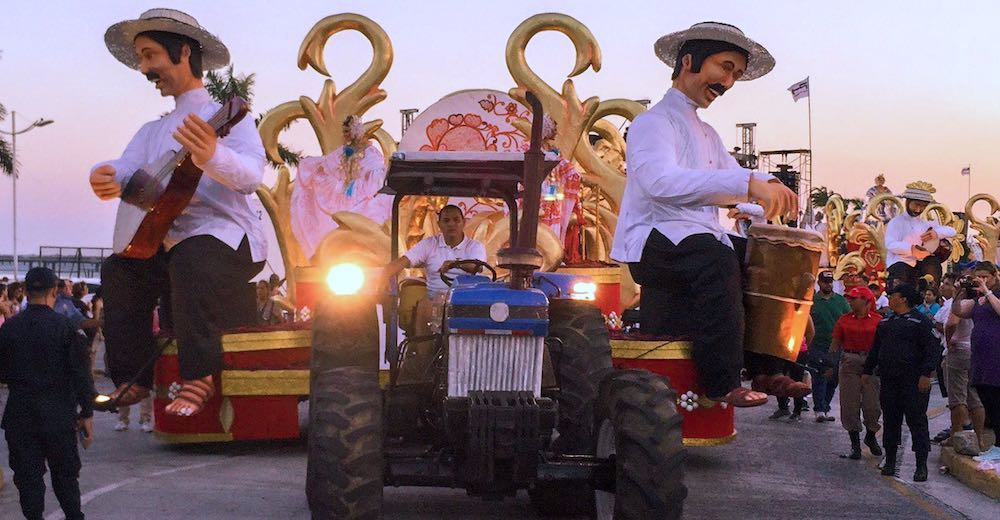Tractors pulling the floats during carnavales Panama City
