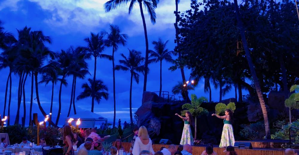 Hawaiian phrases luau and hula apply to this picture of a Hawaiian feast with dance performances