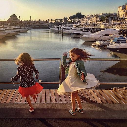 Little girls dancing at the Vilamoura marina