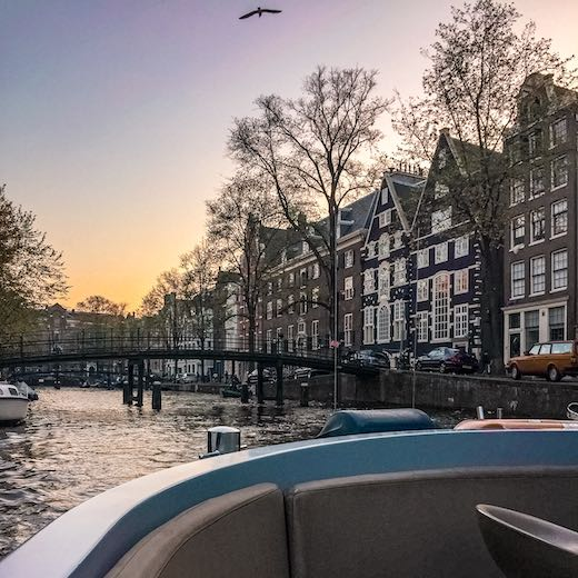 Sunset during an evening canal cruise in Amsterdam