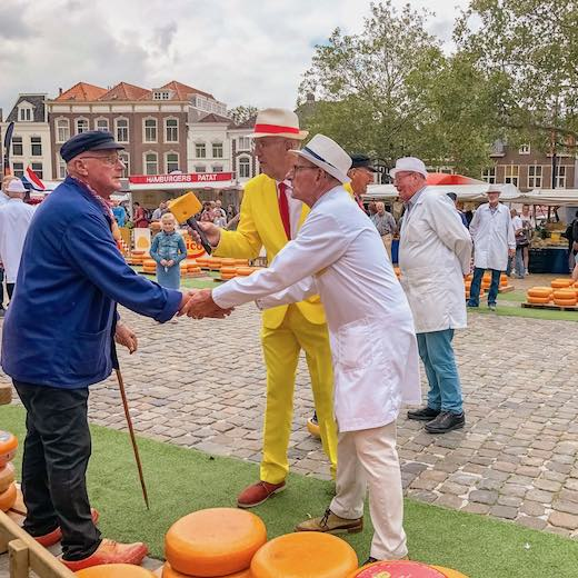 Negotiating on the price at Gouda cheese market in Gouda The Netherlands